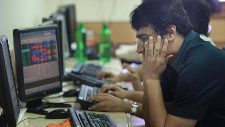 Sensex flat with negative bias; Nifty trades at 10272