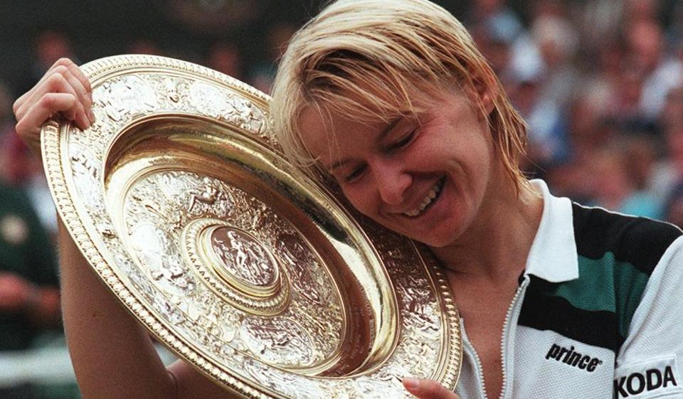 An old photo of Jana Novotna shows her enjoying Wimbledon women's singles triumph in 1998. She died at 49 on Monday after suffering from cancer. (AFP)