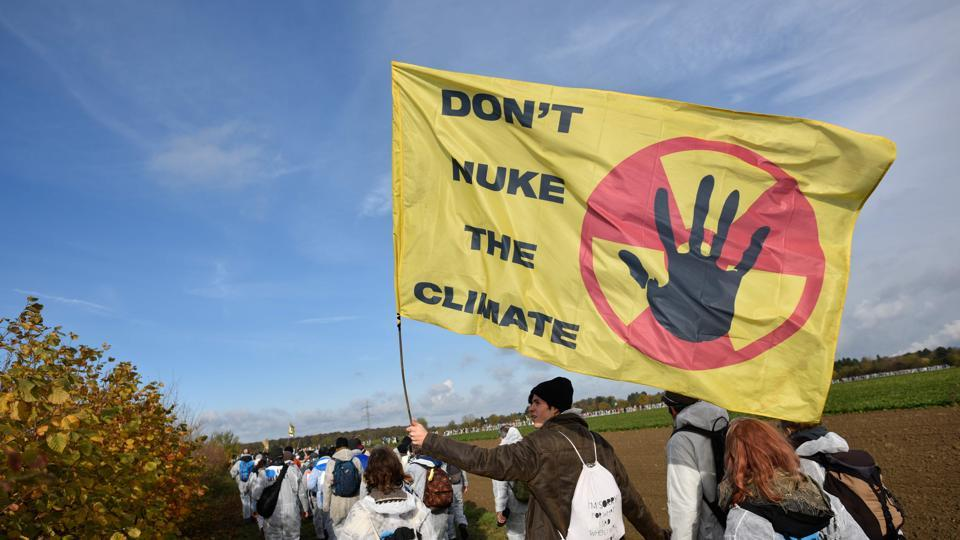 Environmentalist march close to the Hambach lignite open pit mine near Elsdorf, Germany, on November 5, 2017, as they protest against fossil-based energies like coal, having negative impact on the climate change