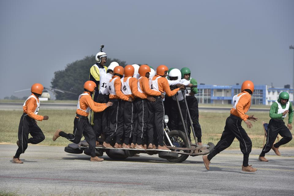 The team initially began with 24 members on the motorbike, adding additional members carefully to its flanks as it picked pace and covered the 1.2 km distance down the track. (Arijit Sen / HT Photo)