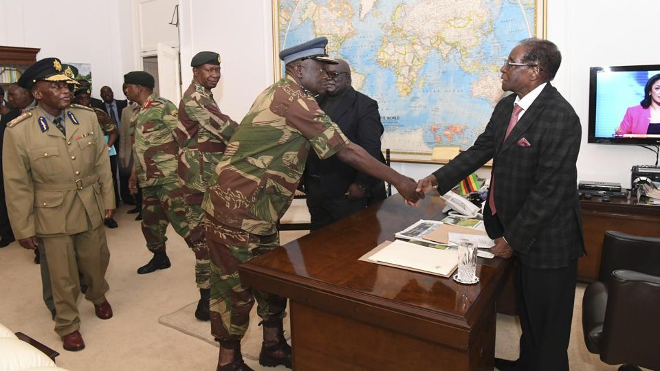 President Robert Mugabe meets with senior members of the Zimbabwe Defence Forces and police at State House in Harare, Zimbabwe on November 19, 2017. In a televised address that night, the 93-year-old president flouted expectations he would step down after the takeover, blithely declaring that he would chair a top-level meeting of the party that had just disavowed him. (AP)