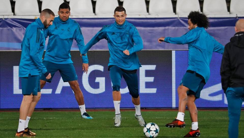Real Madrid's Portuguese forward Cristiano Ronaldo (C) takes part in a training session at the GSP Stadium in the Cypriot capital Nicosia, on Monday.