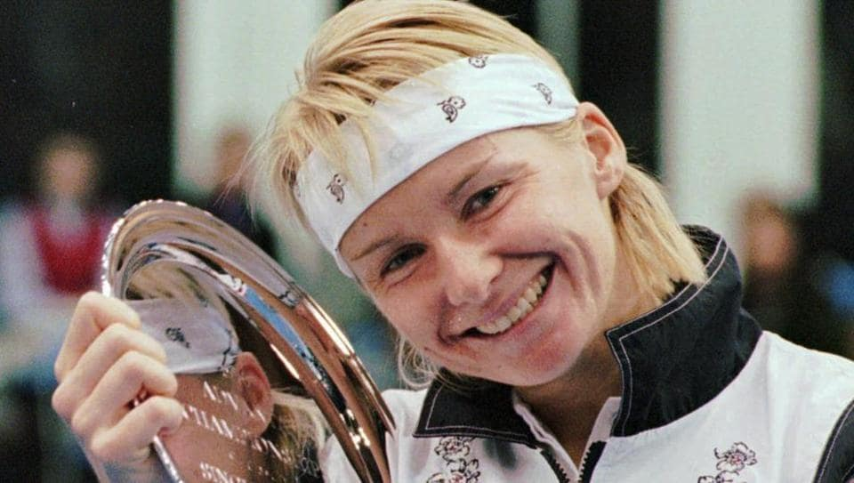 In this Nov. 17, 1996 file photo, Jana Novotna, of the Czech Republic, is all smiles after taking home a $79,000 check from the Advanta Tennis Championship in Villanova, Pa. The 1998 Wimbledon champion from Czech Republic has died battling cancer on Sunday, Nov. 19. She was 49.