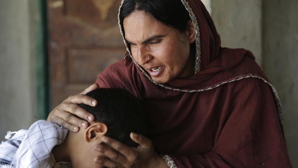In this picture taken on May 4, 2017, Kausar Parveen comforts her son who was allegedly raped by a mullah in Kehror Pakka, Pakistan. The Associated Press interviewed more than a dozen children or relatives of children who had been sexually assaulted by a cleric at the madrassa where they studied.