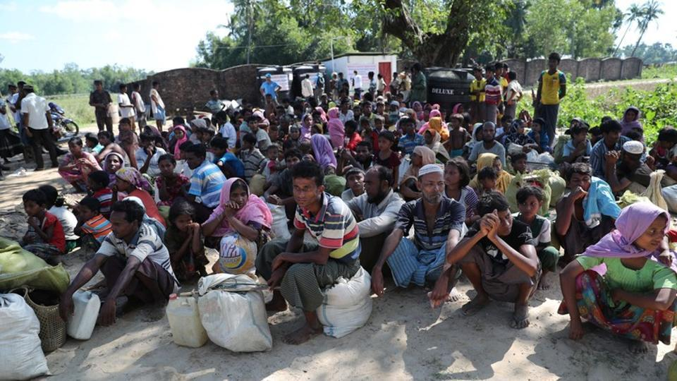 Rohingya refugees who crossed the border are temporarily detained by Border Guard Bangladesh in Cox's Bazar on Sunday.