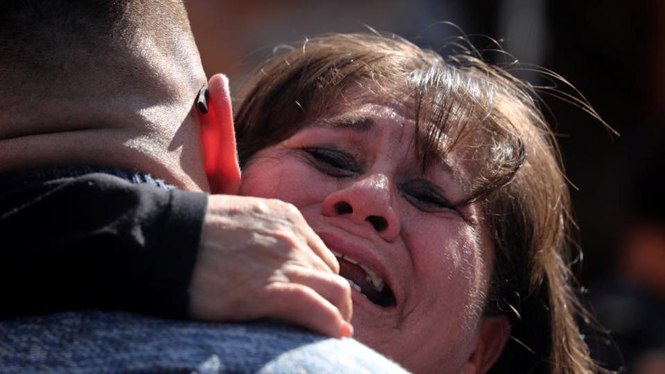 "A mother and son embrace as patrol agents open the gate to allow selected families to meet along the US-Mexico border. The Border Angels group takes meeting requests from families and forwards the names to the State Department, which conducts checks and makes the final decision. ""While some people want to build walls, we want to open doors"", Morones said. (Mike Blake / REUTERS)"