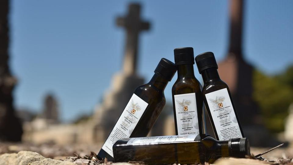The last bottles of 2017's limited-edition olive oil, released to mark the 180th anniversary of the West Terrace Cemetery in Adelaide. From the graveside to the dinner plate, olive oil harvested from centuries-old trees at an Australian cemetery is just the latest by Australian authorities in a bid to shake up people's attitudes towards death and burial sites. (Peter Park / AFP)