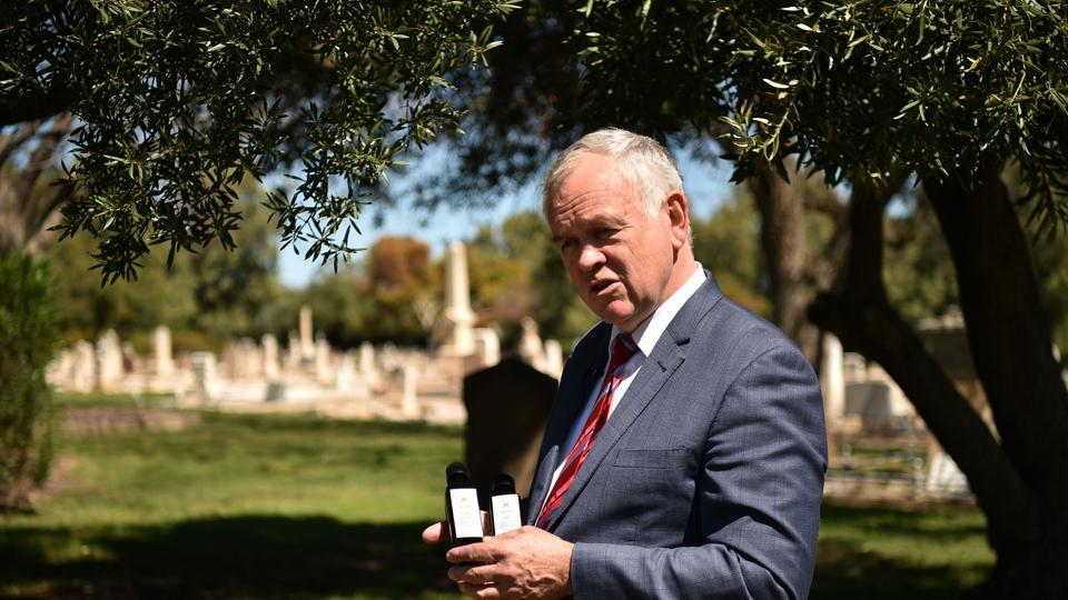 """Trying to sell death is very hard, no-one wants to buy it,"" Adelaide Cemeteries Authority chief executive Robert Pitt said as olive trees rustled above ageing headstones. ""However, if we're selling olive oil or selling an experience... (it's) where the real value of coming to a cemetery is. And there's definitely a sense of place here. There's a sense of reverence and a sense of history."" (Peter Parks / AFP)"