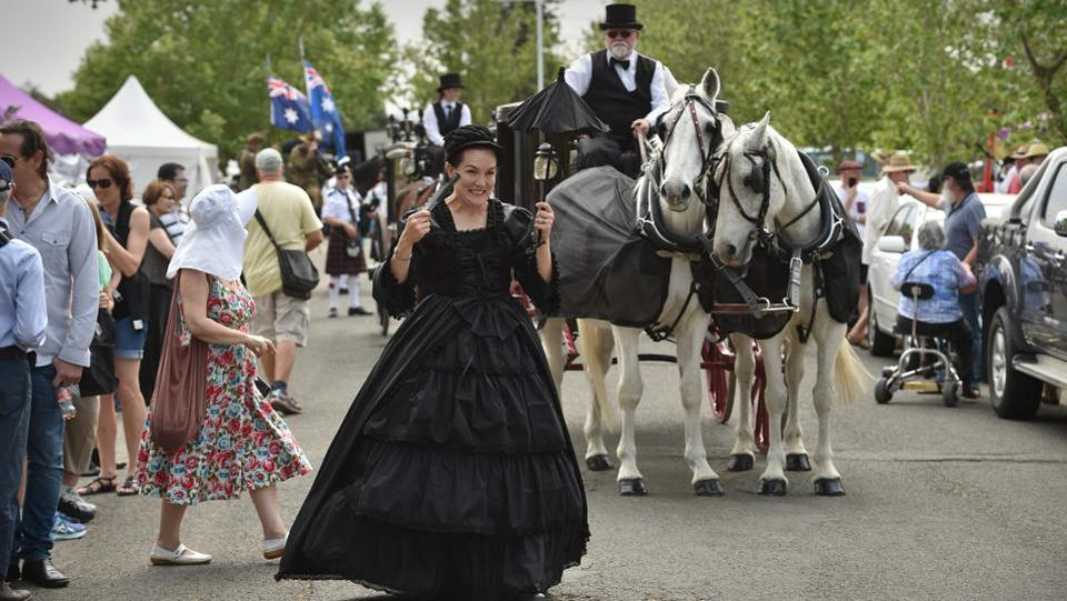 "A woman in Victorian clothing leads a horse-drawn hearse before a parade commemorating the 150th anniversary of Rookwood. This ""necropolis"", the final resting place for more than a million people, has drawn crowds by hosting open days, annual sculpture walks and even bike races. Its recent commemoration featured live jazz music, grave-digging demonstrations and face-painting for children. (Peter Parks / AFP)"