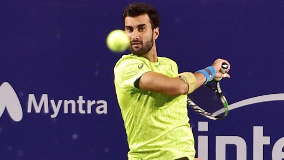 Indian tennis player Yuki Bhambri plays against Pedro Martinez of Spain during the Bengaluru Open 2017 ATP Challenger at KSLTA on Wednesday..