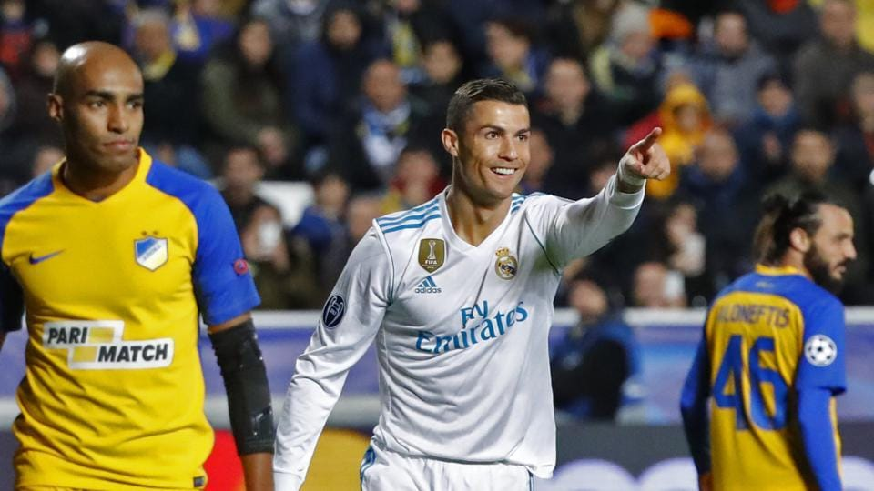 Real Madrid's Portuguese forward Cristiano Ronaldo (C) celebrates his first goal, and his team's fifth, during the UEFA Champions League Group H match against APOEL on Tuesday. (AFP)