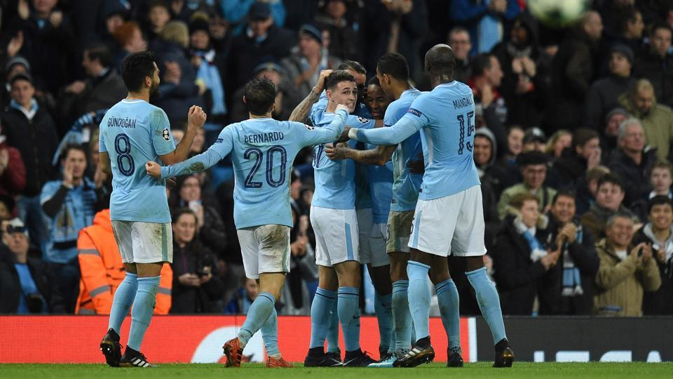 Manchester City's English midfielder Raheem Sterling (3R) is surrounded by team-mates after scoring the only goal for his side in the 1-0 win over Feyenoord. (AFP)
