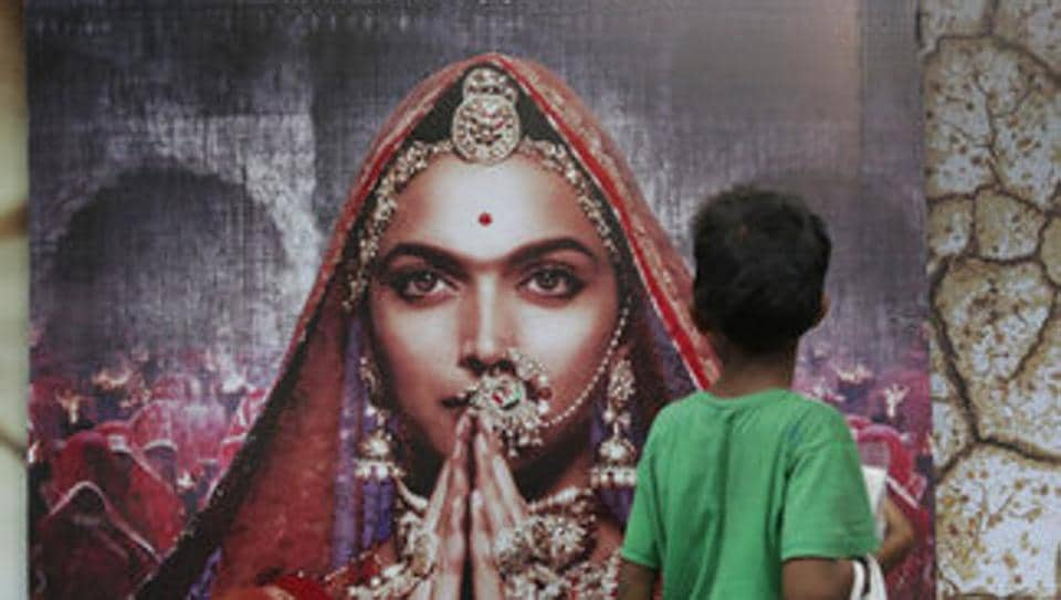 A boy looks at a poster of Bollywood film Padmavati featuring Deepika Padukone in Mumbai.  The film has banned in Gujarat and Madhya Pradesh.