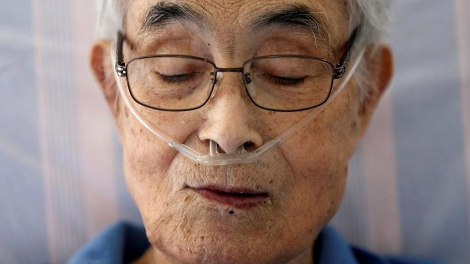 Katsuo Saito, 89, who had leukaemia, uses an oxygen tube as he rests at his house in Tokyo. After being diagnosed with leukaemia in July, Saito decided to not seek treatment and opted instead for palliative care. He had a hard time finding a bed at a hospice or hospital, so he spent most of his remaining weeks at home. (REUTERS)