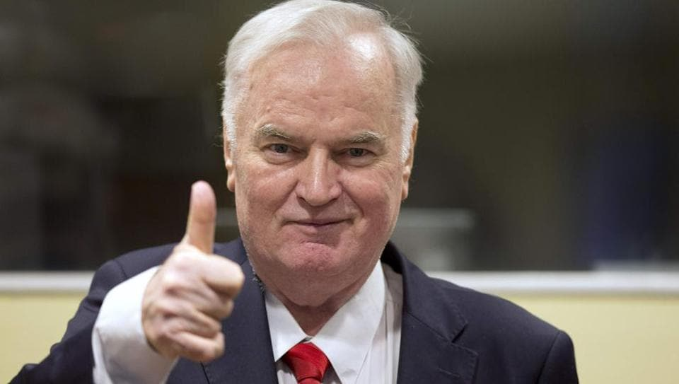 Bosnian Serb military chief Ratko Mladic thumbs up as he enters the International Criminal Tribunal for the former Yugoslavia (ICTY), on November 22, 2017, to hear the verdict in his genocide trial.