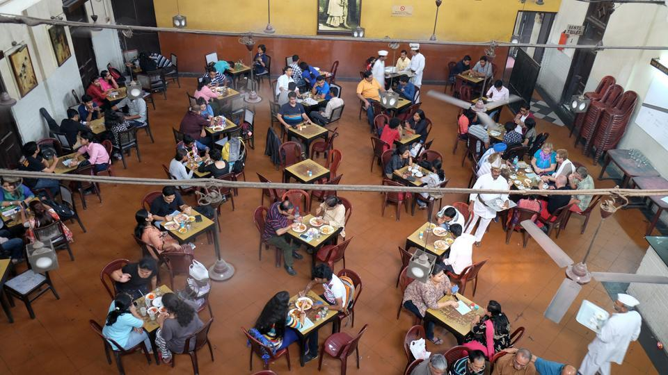 Visitors of at the Indian Coffee House have lunch in Kolkata. The India Coffee House chain was started by the Coffee Cess Committee in 1936 in Mumbai.