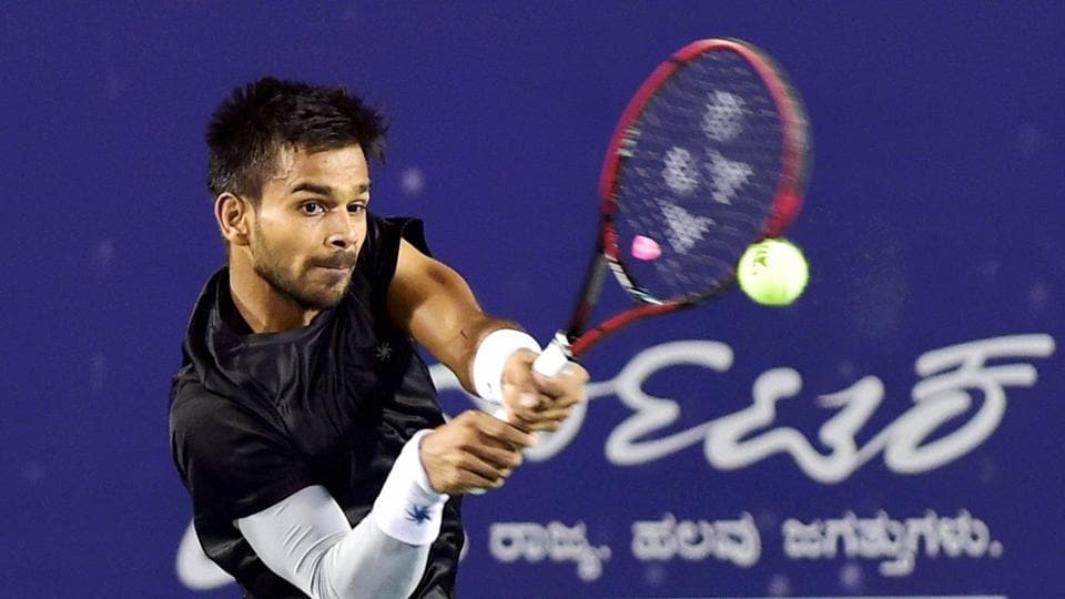 Sumit Nagal returns to top seed Blaz Kavcic of Slovenia during the quarterfinals of the Bengaluru Open ATP Challenger tennis tournament at KSLTA on Thursday. Nagal won the match by 6-3, 6-4.