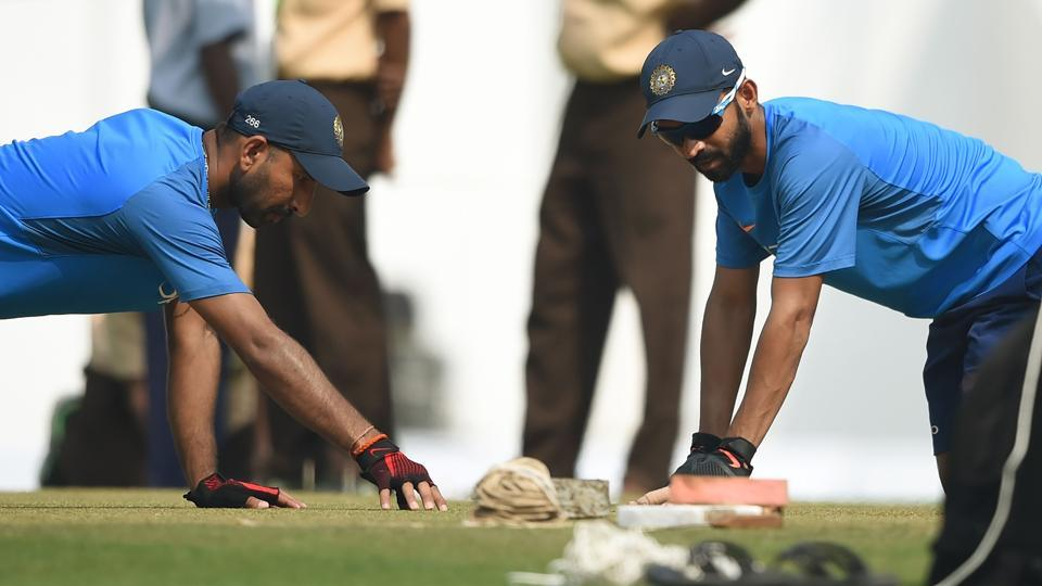 Cheteshwar Pujara (L) and Ajinkya Rahane inspect the pitch during training. Both will be key members of the Indian batting line up.  (AFP)