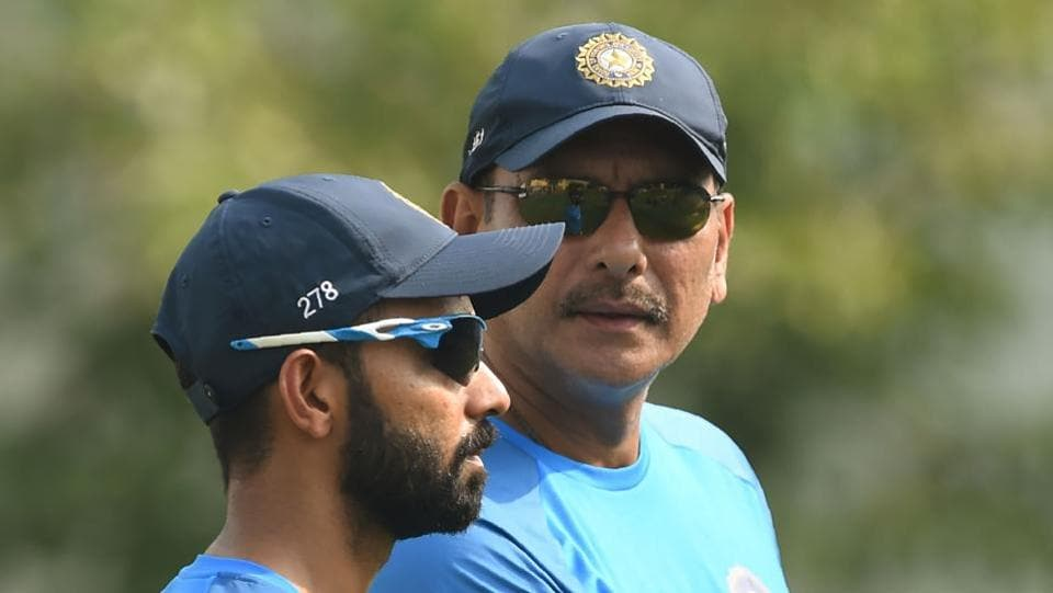 Indian cricket team coach Ravi Shastri (R) chats with Ajinkya Rahane during the training session.  (AFP)