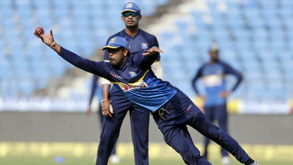 Sri Lanka cricket player Dilruwan Perera catches a ball during practice.  (AP)