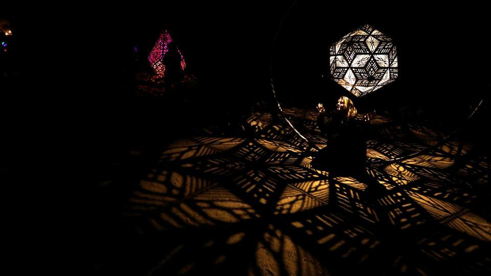 "The ""Celestial Shadows"" exhibit is a captivating series of laser-cut pendants from the HYBYCOZO series by Yelena Filipchuk and Serge Beaulieu. Kaleidoscopic patterns streaming through the latticework swirl over the ground when given a nudge or twirl. (Mario Anzuoni / REUTERS)"