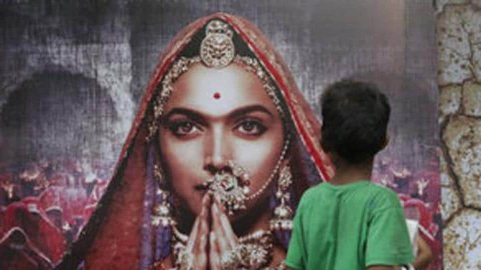 A boy looks at a poster of Bollywood film 'Padmavati' featuring Deepika Padukone in Mumbai on Tuesday.