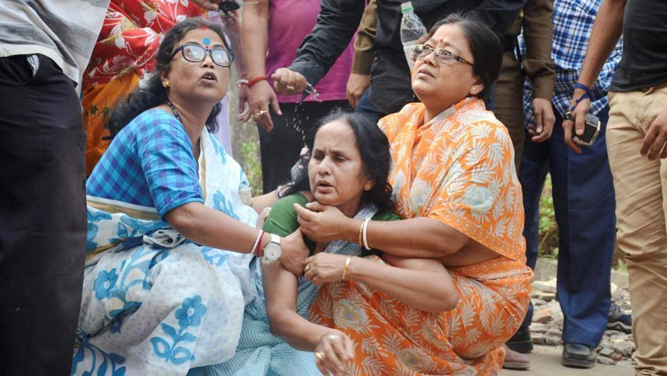 Women console a relative of the slain journalist in Agartala. Bhowmik, who worked with the Bengali newspaper, Syandan Patrika, and a news channel, Vanguard, as an investigative journalist had gone to the TSR's 2nd battalion, for a story on Tuesday where he reportedly had an altercation with the commandant Tapan Debbarma and was shot by his personal guard Nandagopal Reang. (PTI)