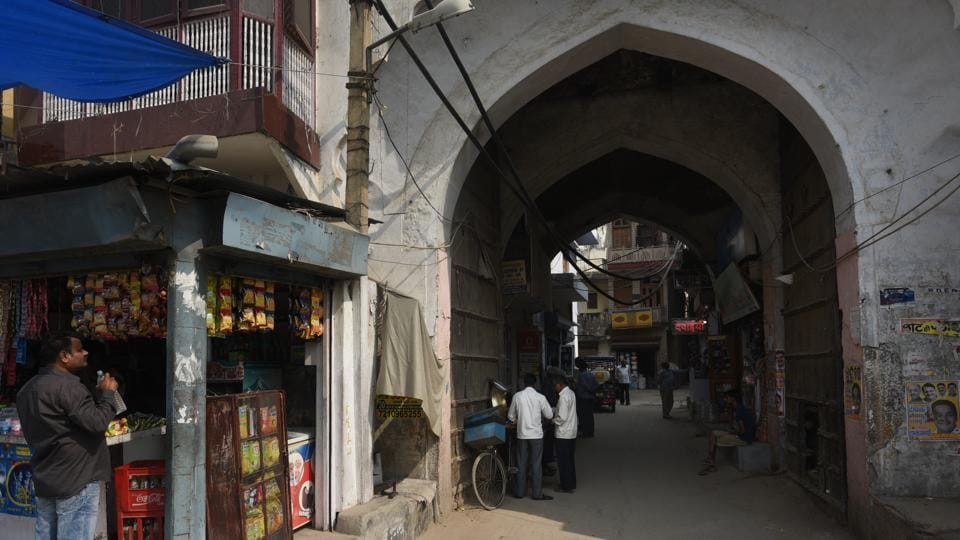Mehram Nagar village --a settlement that came up near the sarai-- opens with an imposing double-storey gateway with pointed arch openings, fitted with a huge wooden door. The ensemble of monuments has decayed to a wretched state. Though the sarai originally had three gateways, only one is still left standing. (Vipin Kumar / HT Photo)