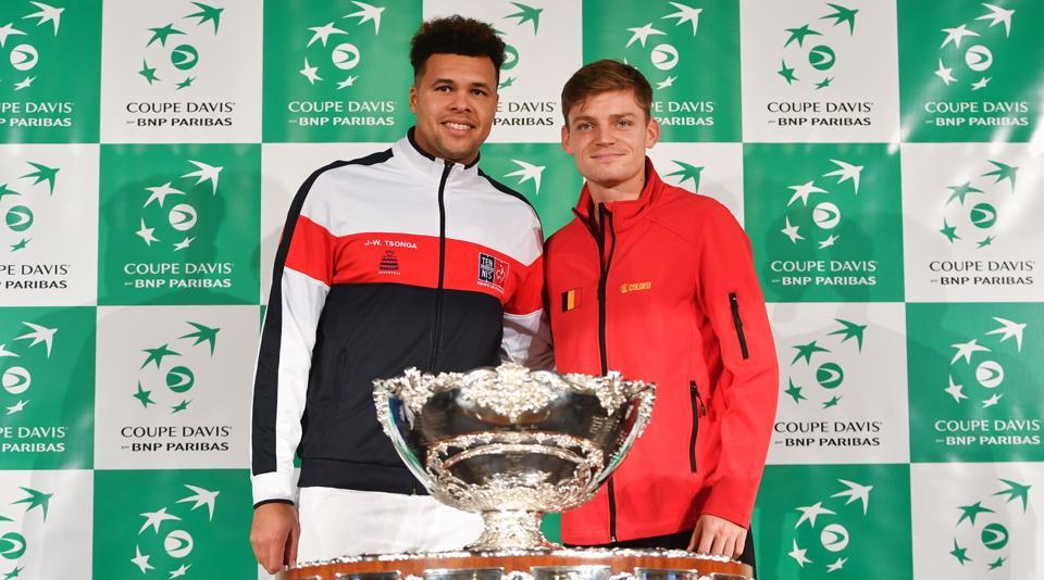 France's Jo-Wilfried Tsonga (L) poses with Belgium's David Goffin during the team presentation in Villeneuve-d'Ascq on Thursdayahead of the Davis Cup World Group final.