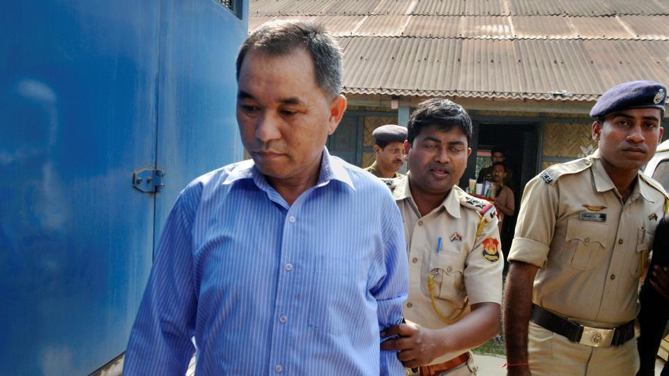 Police escorts the bodyguard of the TSR Second Battalion Commandant Tapan Debbarma, to a court in connection with the killing of the senior journalist. Debbarma and TSR trooper Nandagopal Reang were arrested and produced before a court on Wednesday. (PTI)