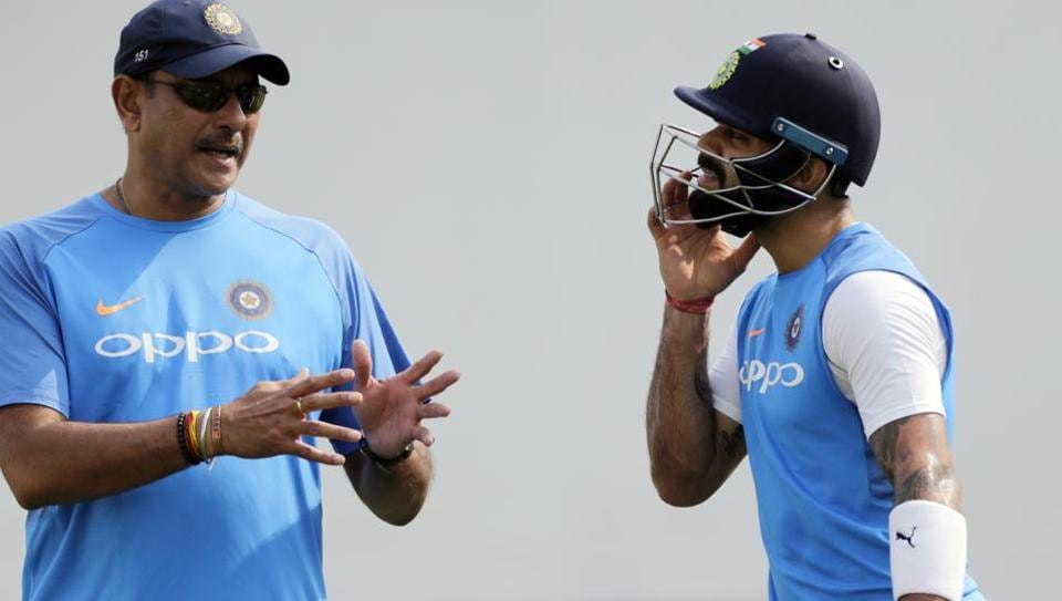 India cricket captain Virat Kohli, right, speaks with team head coach Ravi Shastri during a practice session before their second Test match against Sri Lanka in Nagpur on Thursday.