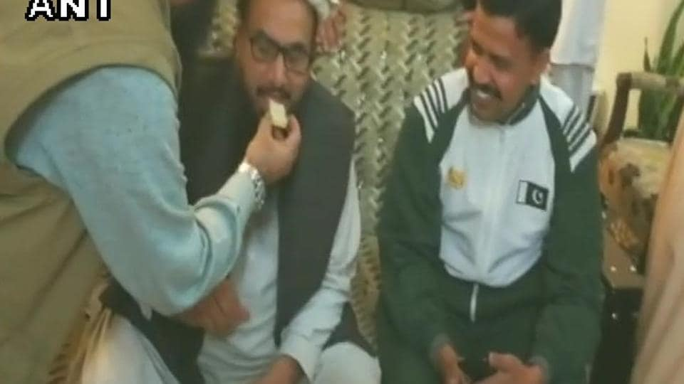Mumbai attack mastermind Hafiz Saeed celebrates after walking free from house arrest in Lahore.