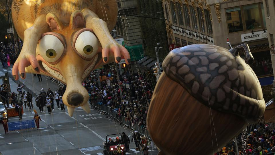 Ice Age's Scrat was still chasing his acorn during the 93rd Macy's Thanksgiving Day Parade in New York on November 23, 2017. Millions applauded marching bands, elaborate floats and enormous tethered balloons in New York's traditional Macy's Thanksgiving Day parade, packing sidewalks as Thanksgiving festivities dotted the US. Elsewhere, community feasts and Black Friday deals brought shoppers out in large numbers. (Carlo Allegri / REUTERS)