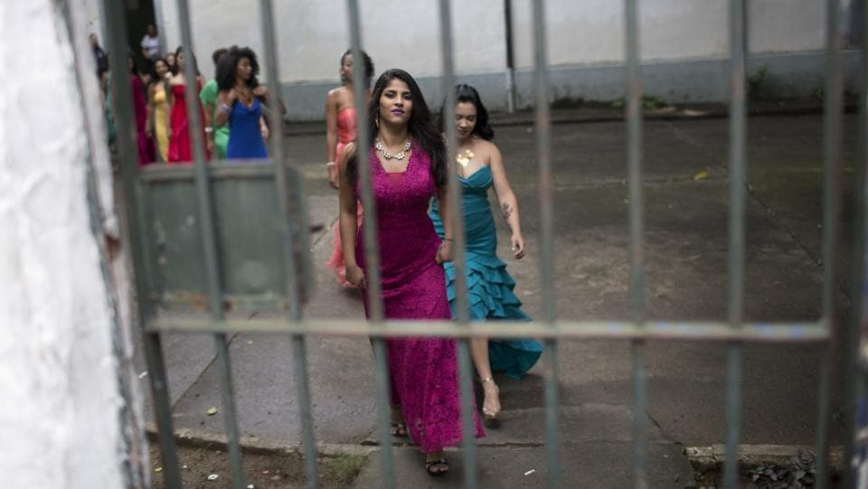 Female inmates wear evening gowns on the morning of the annual beauty contest at the penitentiary in Brazil. (Silvia Izquierdo / AP)