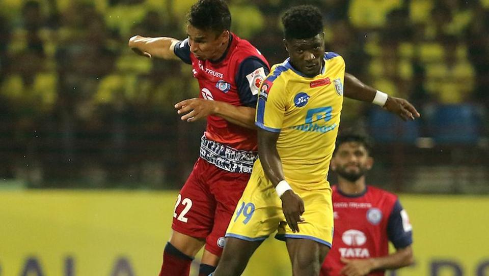 Emerson Gomes De Moura of Jamshedpur FC and Courage Pekuson of Kerala Blasters FC in action during an Indian Super League match at the Jawaharlal Nehru Stadium in Kochi onFriday.