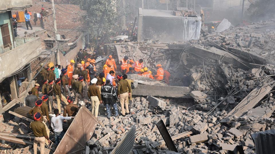 Rescue operations seen underway on the day the building collapsed in Ludhiana on November 20, 2017. The multi-storey factory had caught fire before collapsing hours later. Poisonous gases erupting out of the factory had converted the area into a gas chamber, forcing rescuers to wear masks as they struggled against time to extricate survivors.  (Gurpreet Singh / HT Photo)