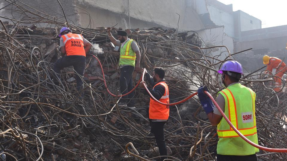 NDRF and fire fighter personnel participating in rescue operations on the fifth day after a five storied building collapsed at Mushtaq Gunj area near Suffian Chowk Ludhiana on Friday.