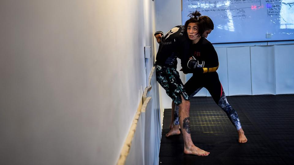 Miao Jie, a mixed martial arts (MMA) fighter during a session with her trainer in Shanghai. The 30-year-old Shanghai native and single mother stands 2-0 in Asia's ONE Championship professional MMA promotion, setting back-to-back women's records by ferociously blitzing her opponents to win in just 49 and then 45 seconds. (Chandan Khanna / AFP)