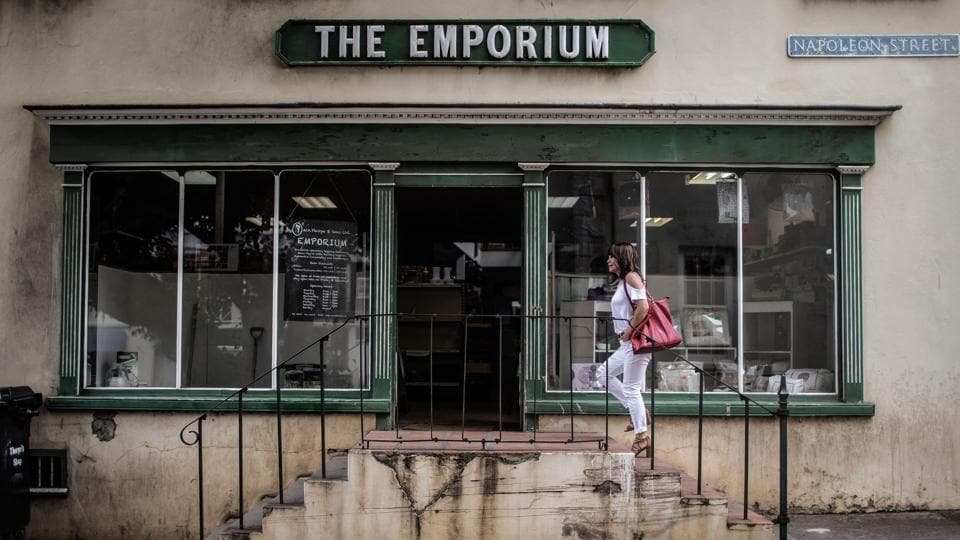 A woman walking up the stairs of a wholesale shop on Napoleon Street in Jamestown in the British Overseas Territory of Saint Helena.