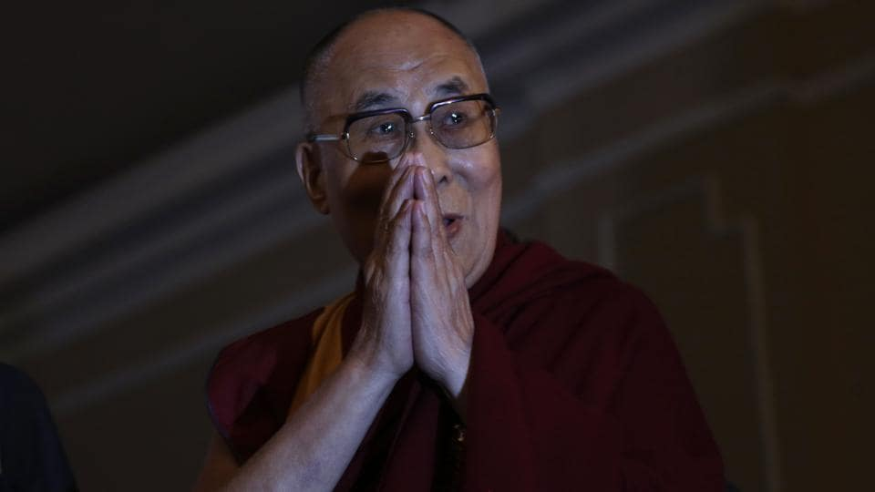 Tibetan spiritual leader  Dalai Lama greets the audience during an interactive session on