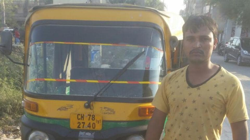 Accused Mohammad Irfan next to the auto that he was reportedly driving that night.