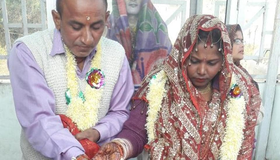 Ajay Tyagi, a farmer from Roorkee's Kuvan Hedi village, (L) with the bride.