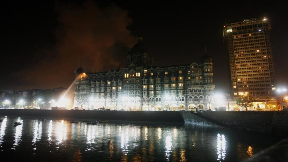 Fire engulfs a part of the Taj Mahal Hotel as firemen attempt  to douse it in Mumbai, India on November  27, 2008.  (Gautam Singh / AP)
