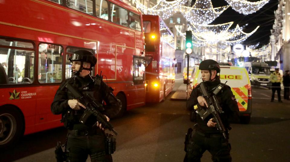 "Armed police officers stand on Oxford Street, London. The area was packed with shoppers seeking ""Black Friday"" bargains and during the panic, several people were injured while fleeing the scene. (Simon Dawson  / REUTERS)"