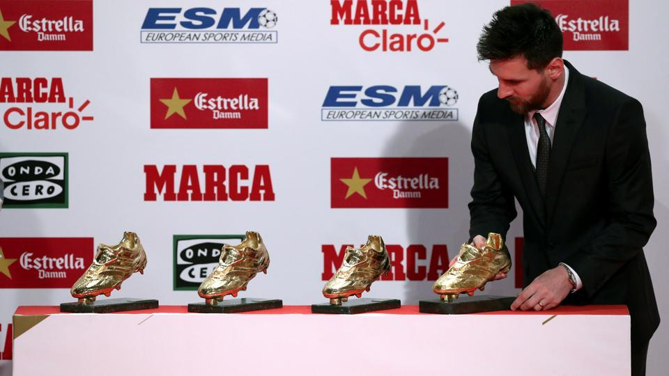 Lionel Messi puts his fourth Golden Boot trophy with the other three.  (REUTERS)