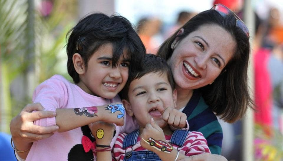 A lady with kids enjoying at the Chandigarh Carnival on Saturday. The three-day long carnival will host a range of competitions for people of all age groups. (Ravi Kumar/HT)
