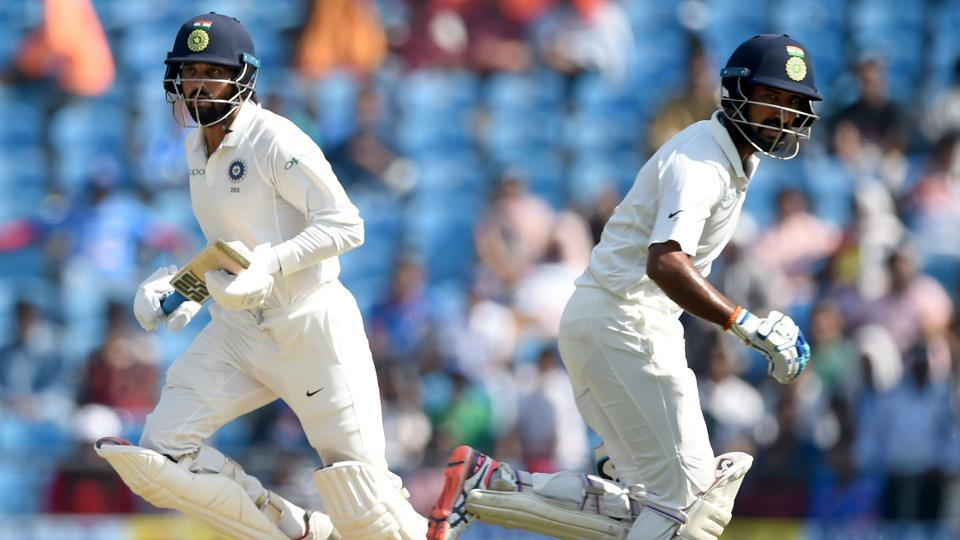 Murali Vijay (L) and Cheteshwar Pujara run between the wickets during the second day of the second Test between India and Sri Lanka at the Vidarbha Cricket Association Stadium in Nagpur.  (AFP)