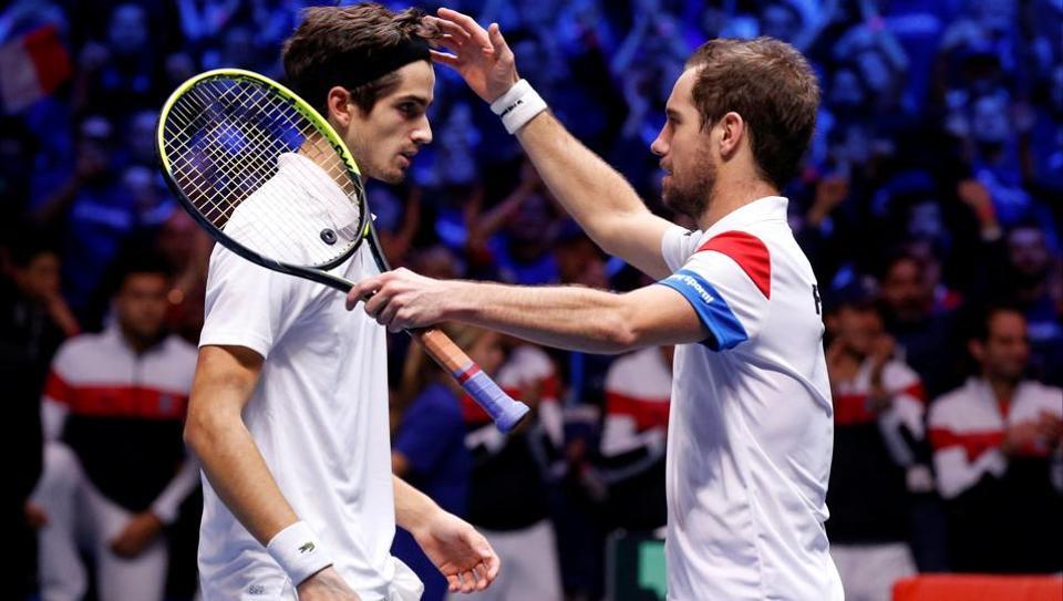 France's Richard Gasquet and Pierre-Hugues Herbert celebrate winning their doubles match against Belgium's Ruben Bemelmans and Joris De Loore in the Davis Cup final.