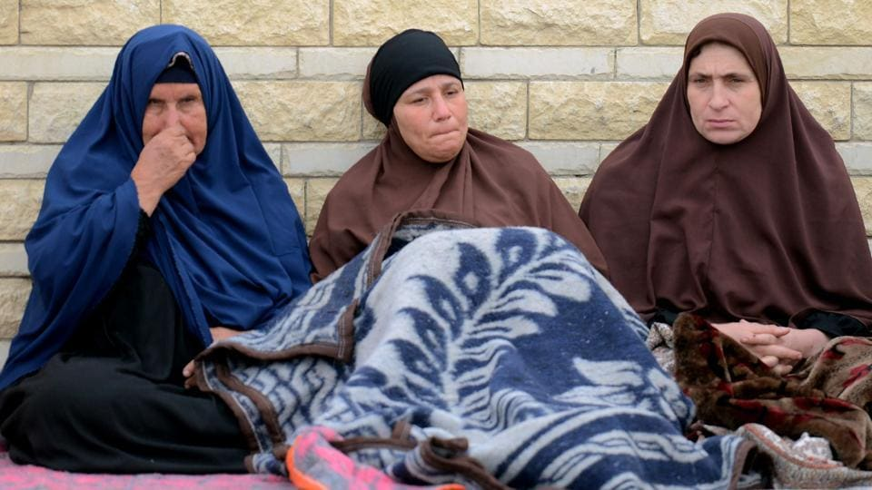 Relatives of the victims of the bomb and gun assault on the North Sinai Rawda mosque sit outside the Suez Canal University hospital in the eastern port city of Ismailia on November 25, 2017, where they were taken to receive treatment following the deadly attack the day before.