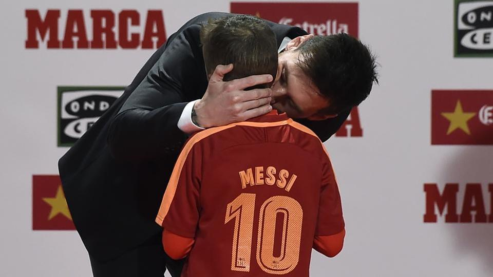 Lionel Messi even found time to celebrate with a young fan of his after receiving the award.  (AFP)